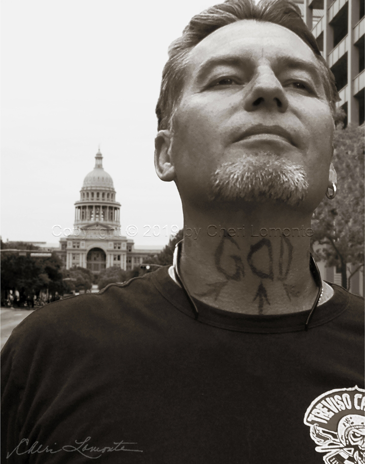 God Focused Man with tattoo in front of the Capitol Building in Austin Texas