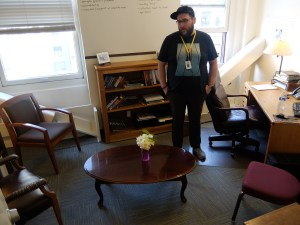 Alex Buck of Seattle's Union Gospel Mission in his office with newly donated carpet from Division 9 Flooring