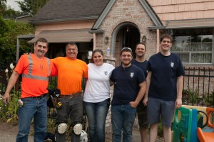 Division 9 Flooring donates materials and installation of new carpet for Rebuilding Together and Paint The Town Blue