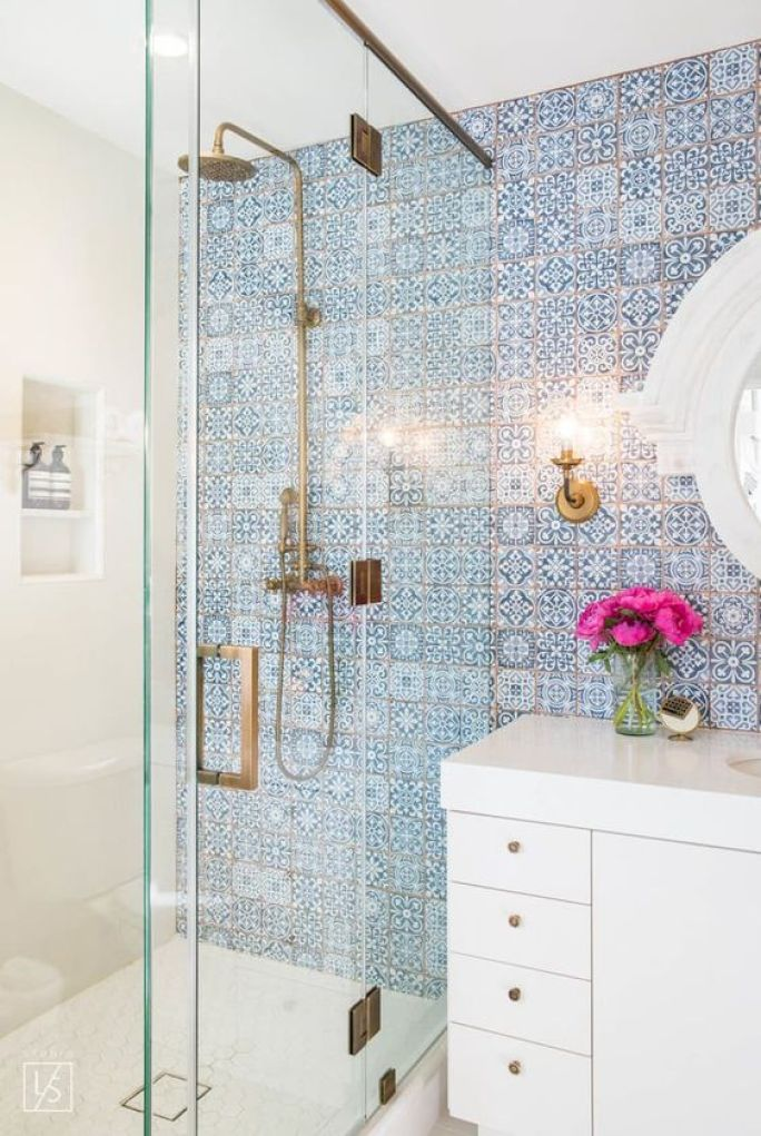 These blue tiles do an AMAZING job at making this bathroom work. It adds a pop of color to keep everything from being to white and plain.