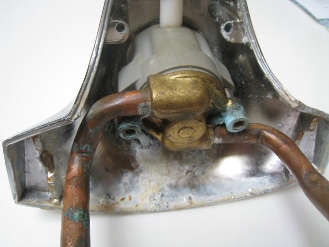 bathroom sink faucet leaking around