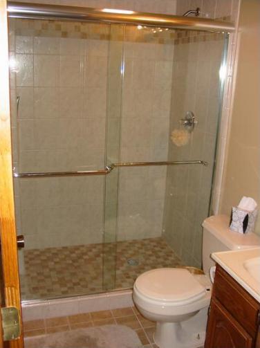 installing shower door on new tile