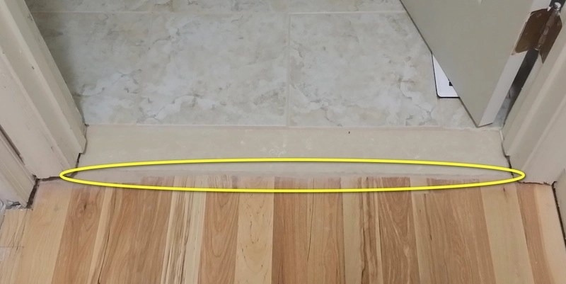 tile to wood transition and door frame