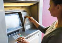 student using atm representing importance of teen checking accounts
