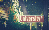 University road sign representing 50-50 colleges