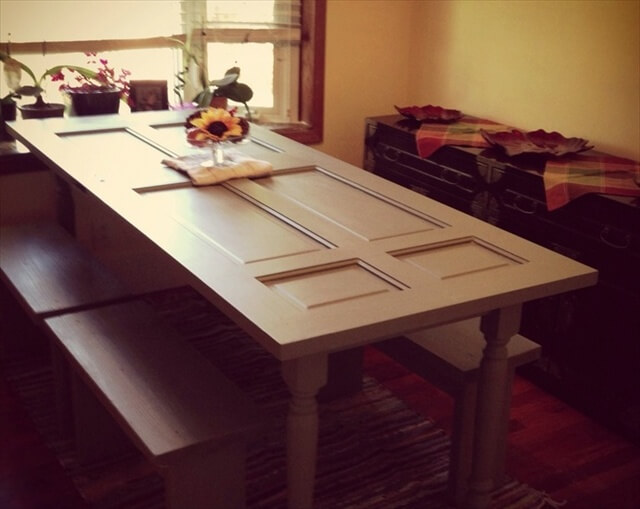 a dining table out of a old door