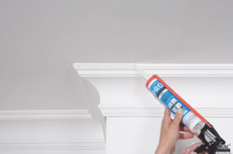 Apply decorators caulk to the edges of the coving