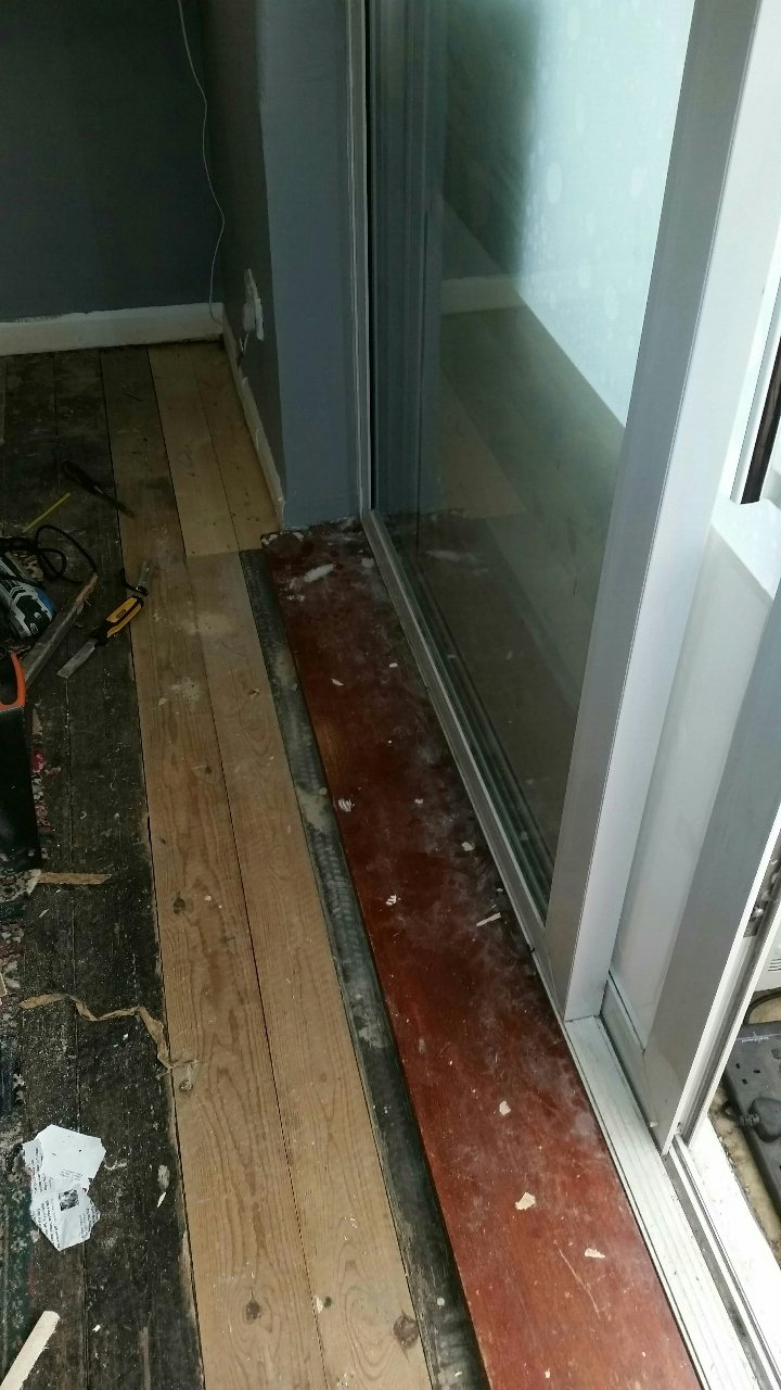 covering a bare brick patio doorway in
