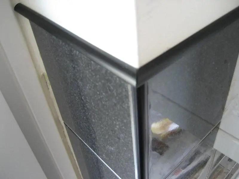 tile trim along top edge of tiles at