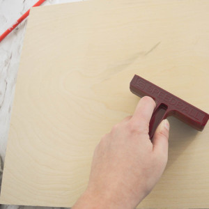 Use a piece of scrap wood and a stamp brayer