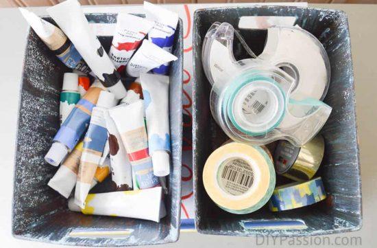 Office supplies in faux distressed metal bins
