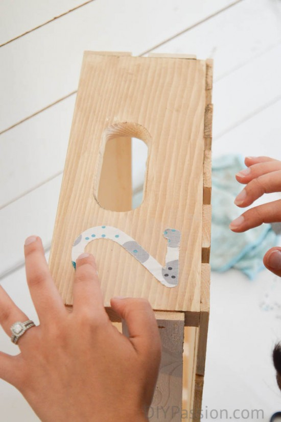 Pressing the applique down with your fingers