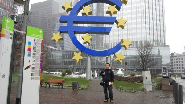 Charles Huang during stopover in Frankfurt.  Photo taken in front of the European Central Bank.