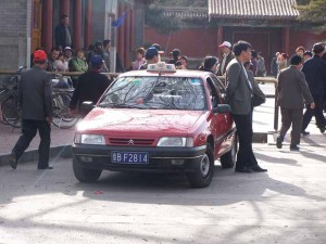 Example of unlicensed, black taxis in Beijing