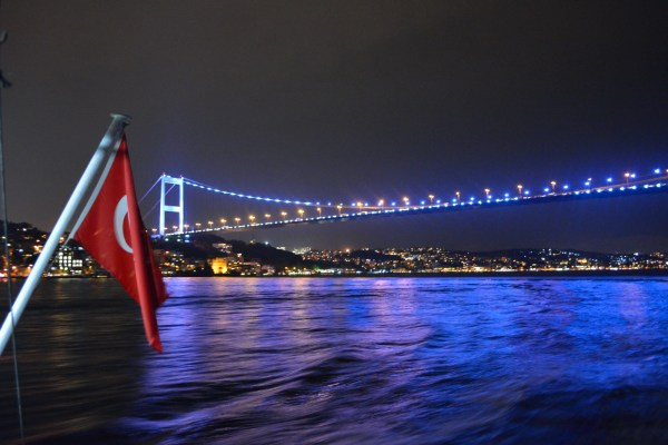 Night Cruise Under Bosphorus Bridge connecting Asia and Europe