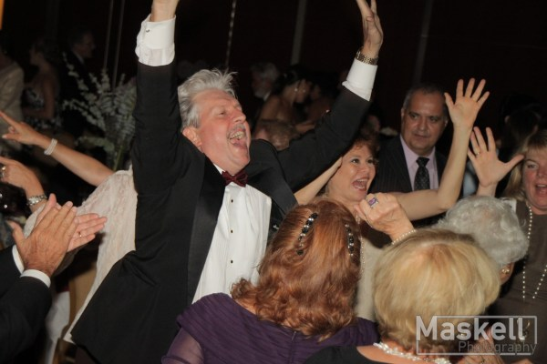 Parents on the dancefloor at a wedding with DJ Maskell