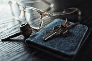 a pipe and a wallet on the table
