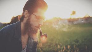 a man smoking outdoors