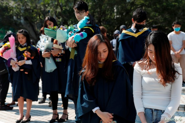 Graduates attend a ceremony to pay tribute to Chow Tsz-lok, 22, a university student who fell during protests at the weekend…