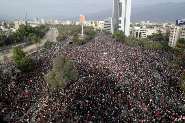 Demonstrators protest against the government in Santiago, Chile, Monday, Nov. 4, 2019. Chile has been facing weeks of unrest,…