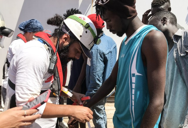 A member of the Medecins sans Frontieres (MSF) registers the details of a rescued migrant onboard the Ocean Viking rescue ship after 81 migrants were rescued from their dinghy in the Mediterranean Sea, Aug. 11, 2019.