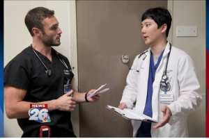 Ballard discusses a patient diagnosis with fourth-year MCG student Jung-Hoon Lee.