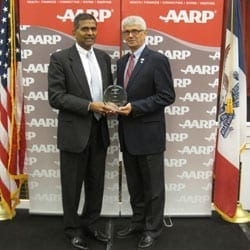 Yogesh Shah, M.D., and Joel Olah, Ph.D., accept the award