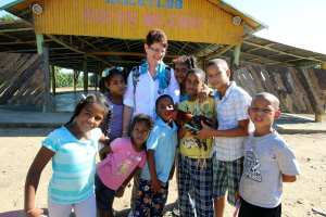 Laura Delaney with kids on a medical mission to the Dominican Republic