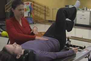 Libby Trausch, D.P.T., helps a patient strengthen her pelvic floor muscles.