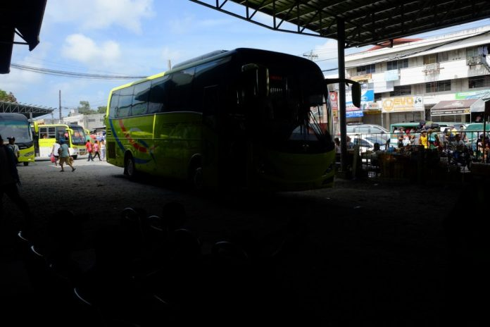 A Ceres bus from southern Negros enters the southern bus terminal at Lopez Jaena Street in Bacolod City. Like the bus shown here entering the shade, the saga of the Yanson's business empire is entering a dark place as the intra-corporate conflict continues to rage. | Photo by Jose Aaron C. Abinosa