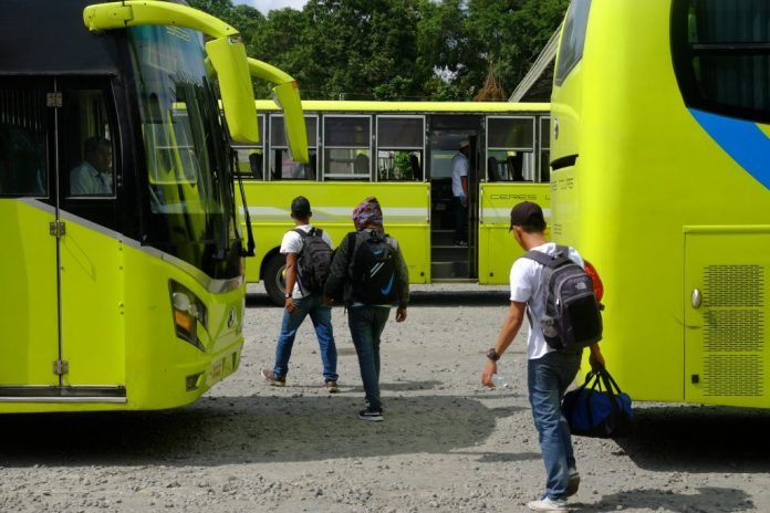Passengers make their way to parked buses of the Ceres Liner at the southern terminal in Bacolod City. | Photo by Jose Aaron C. Abinosa