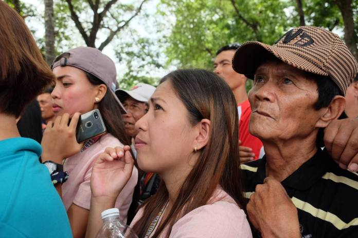 Residents, young and old, in Escalante City, listen to reserve Army Capt. Robin Padilla who spoke during the wreath laying ceremony for the Escalante Massacre commemoration.