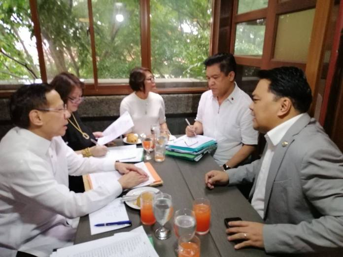 PRESS FOR CORAZON. Bacolod Cong. Greg G. Gasataya, right, meets with Health Sec. Francisco Duque III, left, and other too health officials to discuss additional budget for CLMMRH next year. President Duterte approved August 28 RA1141 authored by Gasataya that increased bed capacity from 400 to 1,000.  Also in photo are Undersecretaries Leonita Gorgolon of the Health Facilities Enhancement Program Management Office, center, and Lilibeth David, Health Facilities and Infrastructure Development Team, seated beside Duque. | Photo by Pao Aguila / Bacolod Congressional Office.