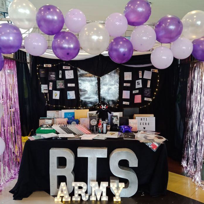 The BTS Army booth that was designed by Angelie Alvarez that has BTS merchandise. Photo by Angelie Alvarez