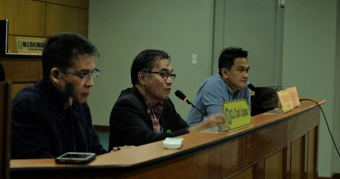 Councilor Carl Lopez, left, leads the joint committee hearing with Councilor Archie Baribar as co-chair, and lone opposition councilor Wilson Gamboa Jr. who was asked to join in. | Photo by Elian P. Quilisadio