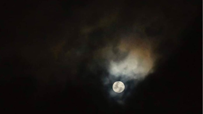 """A young wolf moon shot over the skies of Cebu by award-winning photojournalist Victor Kintanar. He writes on his post """"Tonight's Wolf Moon revealed to me a burning animal. As if souls of the millions of animals trapped in forest fires around the world are saying goodbye."""" 