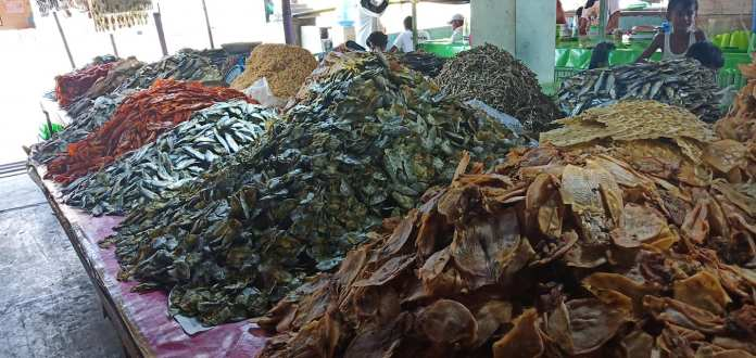 """Variety of dried fishes, also known as """"Uga"""", segregated according to their species at Cadiz city public market. 