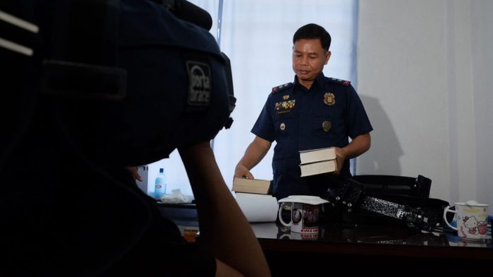 """I am not perfect, that's why I seek God,"" a Bible-packing Lt. Col. Jovie Espenido says 