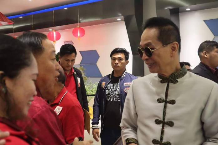 Presidential Spokesman Salvador Panelo, right, talks to businessmen during the Spring Festival gala night in Bacolod City 1 February 2020. | Photo by Ronald Ian D. Evidente