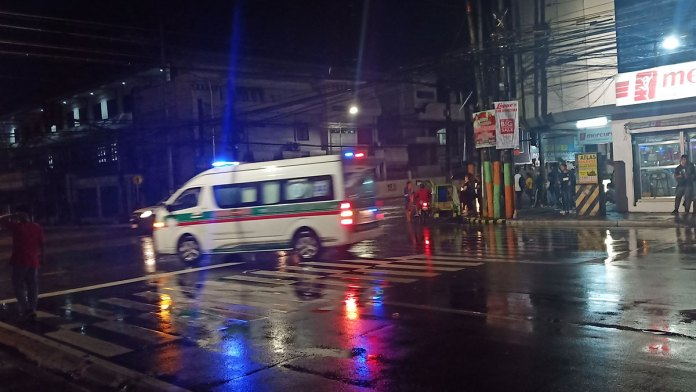 CDRRMO van rushes to the intersection of Burgos-Lacson streets while several stranded people wait for possible utility vehicles going north to pass by. | Photo by Richard D. Meriveles