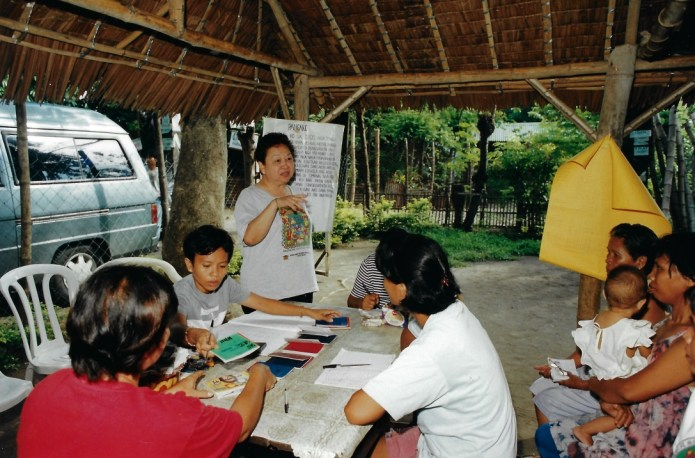 "Dr. Cecilia ""Cecile"" del Castillo conducting a regular center meeting with Dungganon clients. Photo by NWTF. 