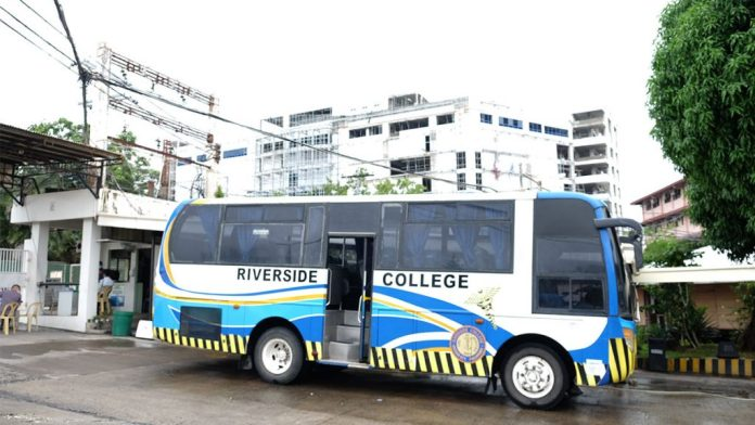 Riverside College has its own bus, sporting the iconic blue of the school.  | Photo by Rodney A. Jarder, Jr.
