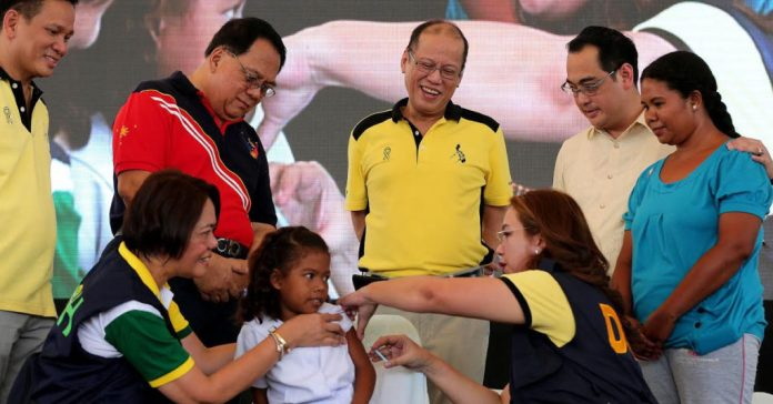 """President Benigno S. Aquino III, together with Interior and Local Government Secretary Mel Senen Sarmiento; and Zambales Governor Hermogenes Ebdane, Jr., witness the ceremonial vaccination of Dengue School-Based Immunization during the launching ceremony and ceremonial distribution of the Tamang Serbisyo Para sa Kalusugan ng Pamilya (TSeKaP) Medical Equipment Package at the People Park in Poblacion, Iba, Zambales on Tuesday (April 05). Also in photo are Health Secretary Janette Garin and Zambales Governor Hermogenes Ebdane, Jr."" by Malacañang Photo Bureau is in the Public Domain, CC0"
