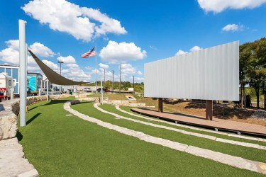 Alamo Drafthouse donated the Community Cinema & Amphitheater. The cinema offers free movie screenings and serves as a venue for community events. We rented out the space for our client appreciation party last year, and we look forward to hosting our friends and families there again in the future!
