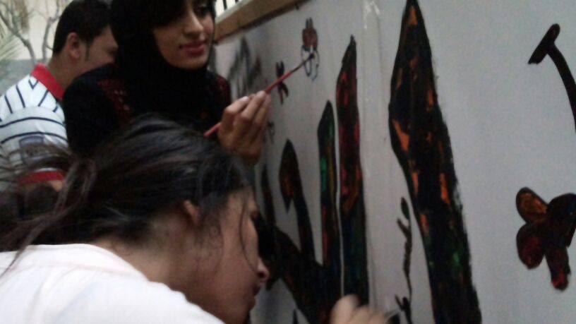 Focused on their work, the crew making grafitti