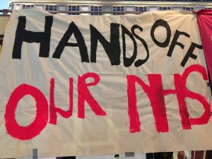 A banner that reads: 'hands off our NHS'