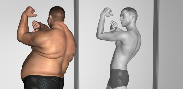 doctor supervised weight loss man looking in mirror