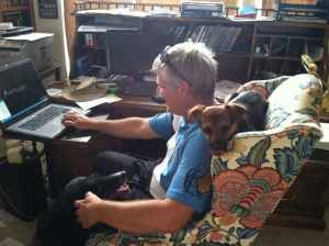 Duck and me, writing.  Oso looks on.