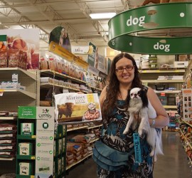 Veronica holding Hestia and a bag of dog food at the pet store