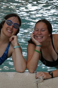 Veronica and Lizzy in the pool, resting their chins on their hands